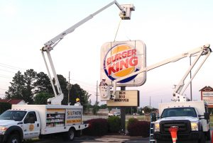 Bucket trucks finishing Burger King sign install