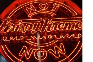 Krispy Kreme Hot Now sign lit up