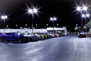 Wide shot of cars in parking lot