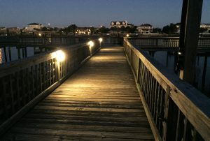 Walkway lighting at sunset with houses